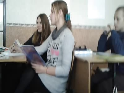 Cute teen girl vaping in classroom