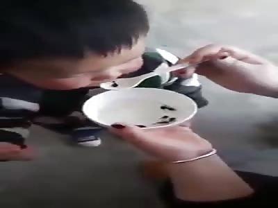Poor asiátic two years old boy eating frog