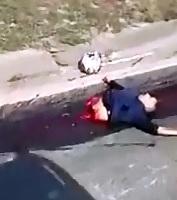 Motorcyclist left Ripped in Half left a Streak of Blood