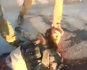 Iraqi soldiers mutilate the body of terrorist ISIS