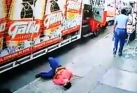 Hitman  puts Bullet in Man Unloading Beverage Truck