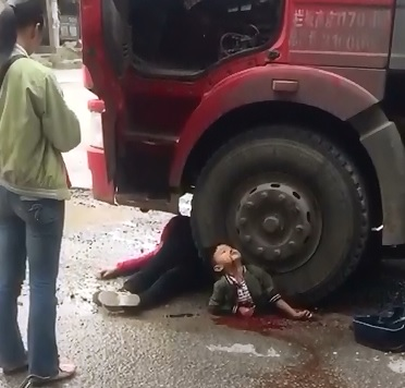 Short Shocking Video of Poor Boy Crushed under Truck