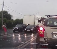 Woman Walking in Traffic During Rain Storm is Struck By Truck