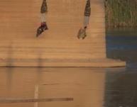 Peshmerga Hung Upside Down on Bridge After Execution
