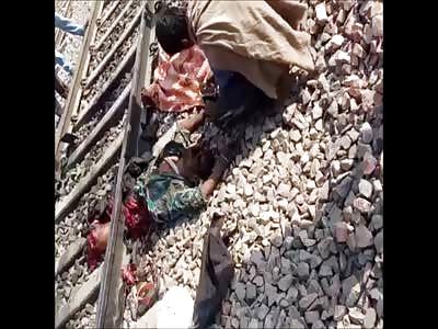 Suicidal Man with Severed Head on Train Tracks