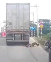 Live Suicide Under Truck Wheel