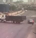 Guy Trying to Speed Around Truck Strikes Worker