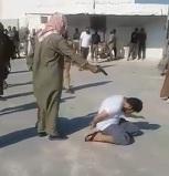Pistol Execution of Cowering Man