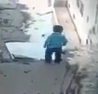 Little Kid Falls in a Huge Pothole Puddle