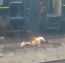 Damn Toasty! Dude Frying on Train Platform (Electrocuted)