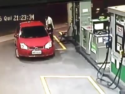 CAR RUNS OVER GAS STATION ATTENDANT