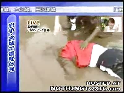 Japanese Reporter breaks his Neck on Live TV