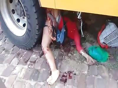 Biker Hemmed Up underneath Bus is a Gory Scene to Watch