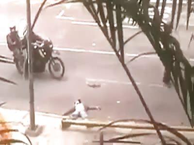 Man convulses while the Bolivarian National Guard assaults him