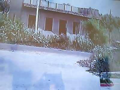 Car runs over motorcyclist and runs away
