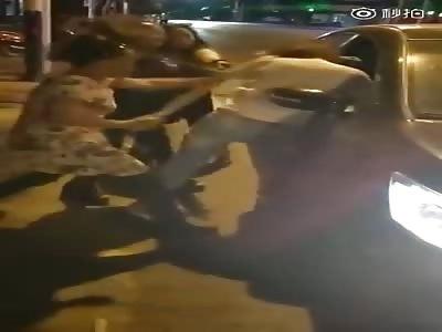 HITTING THE WOMAN