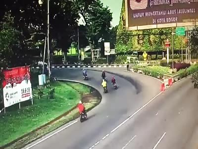 BUS RUNS ABOVE MOTORCYCLIST