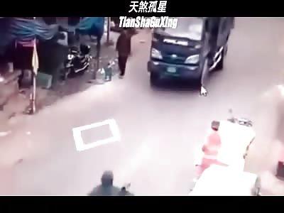 Scooter Boy Run Over by a Dump Truck when Avoiding a Pedestrian