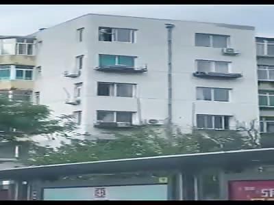 Man Jumps from Sixth Floor Window