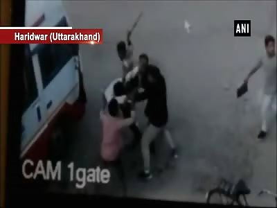 bandits beaten man with sticks