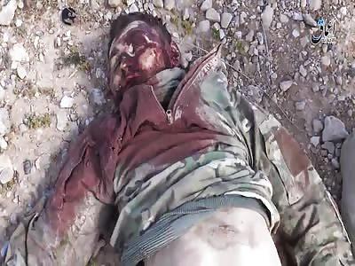 Corpse and Equipment of Russian Mil Adviser Near Palmyra
