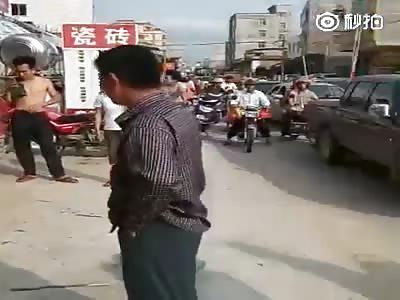 Chinese Street Justice. Bike Thief Beaten in Public