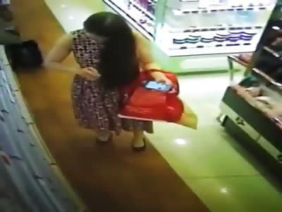 Pretty Woman Apply Body Spray on Her Crotch Inside the Shop