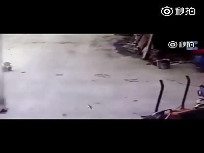 Large truck rolling reversing child
