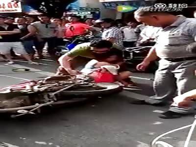Woman gets skirt caught in motorbike wheel