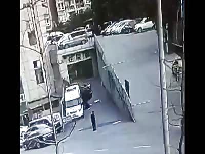 Reversing car hits man off road