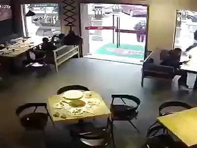 Man breaks glass door.