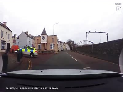 Dashcam Captures Police Car Crashes Into Bollard
