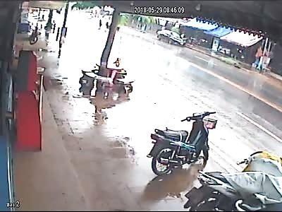 Car Sliding into Tree Captured on CCTV