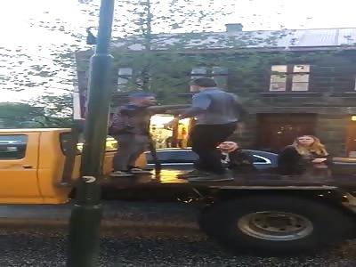 Guy Falls Off Back Of Truck