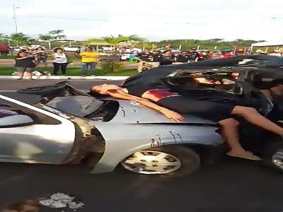 Bodies strewn across road (crash aftermath)