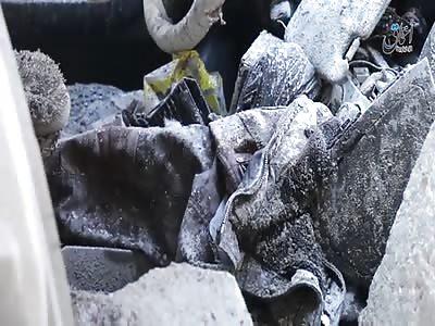 ISIS muestra edificios destruidos y cadáveres múltiple después de