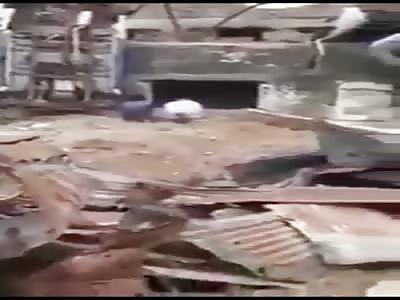 Iraqi soldiers executing 2 men