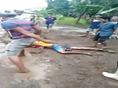 Thief is Beaten Mercilessly by Men in a Village as Villagers Watch