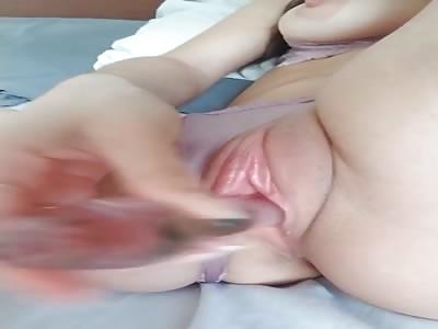 Woman gives henies pleasure by masturbating