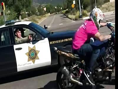 Deputy Pulls Gun On Motorcyclist While Driving...