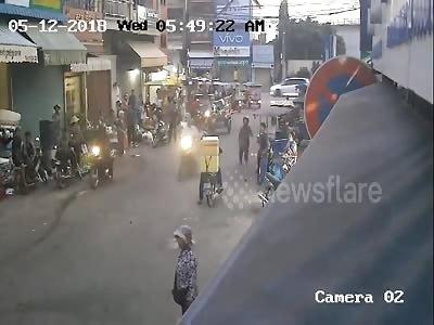 Furious locals karate  kick phone thieves off their getaway bike