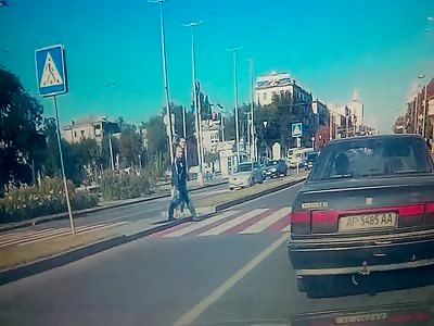 Dude Brutally struck by Car in the Crosswalk Flies Away