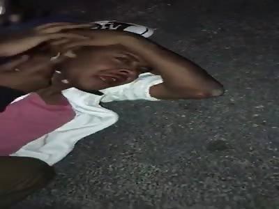 young man beaten with a gun