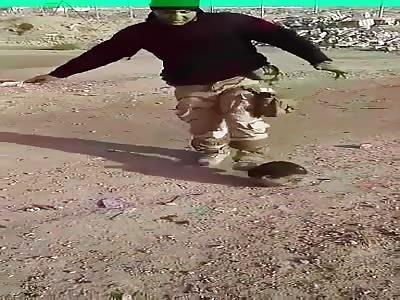 soldier plays with terrorist head