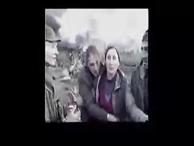 (Fake) Russian soldiers kill chechen civilian in 90s