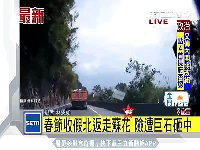 falling rock nearly kills a man in his car