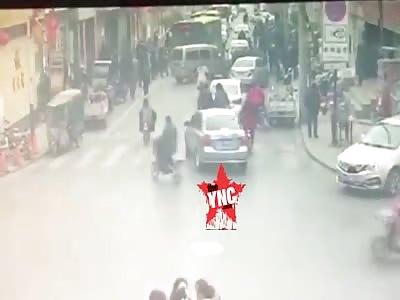 [long shot not zoomed in] many  people crushed by a coach in Zhangjiakou
