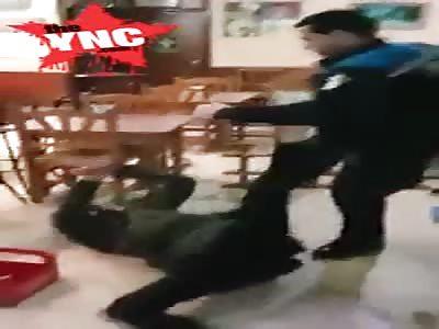Spanish policeman hits a  Moroccan