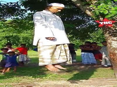 Muslim man hangs from a tree in Bangladesh