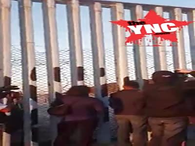 Honduran immigrants try to cross the USA border in Tijuana,Mexico